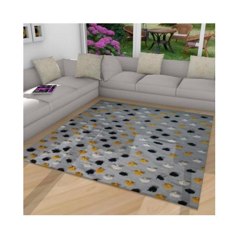 tapis kilim fond gris avec pompons