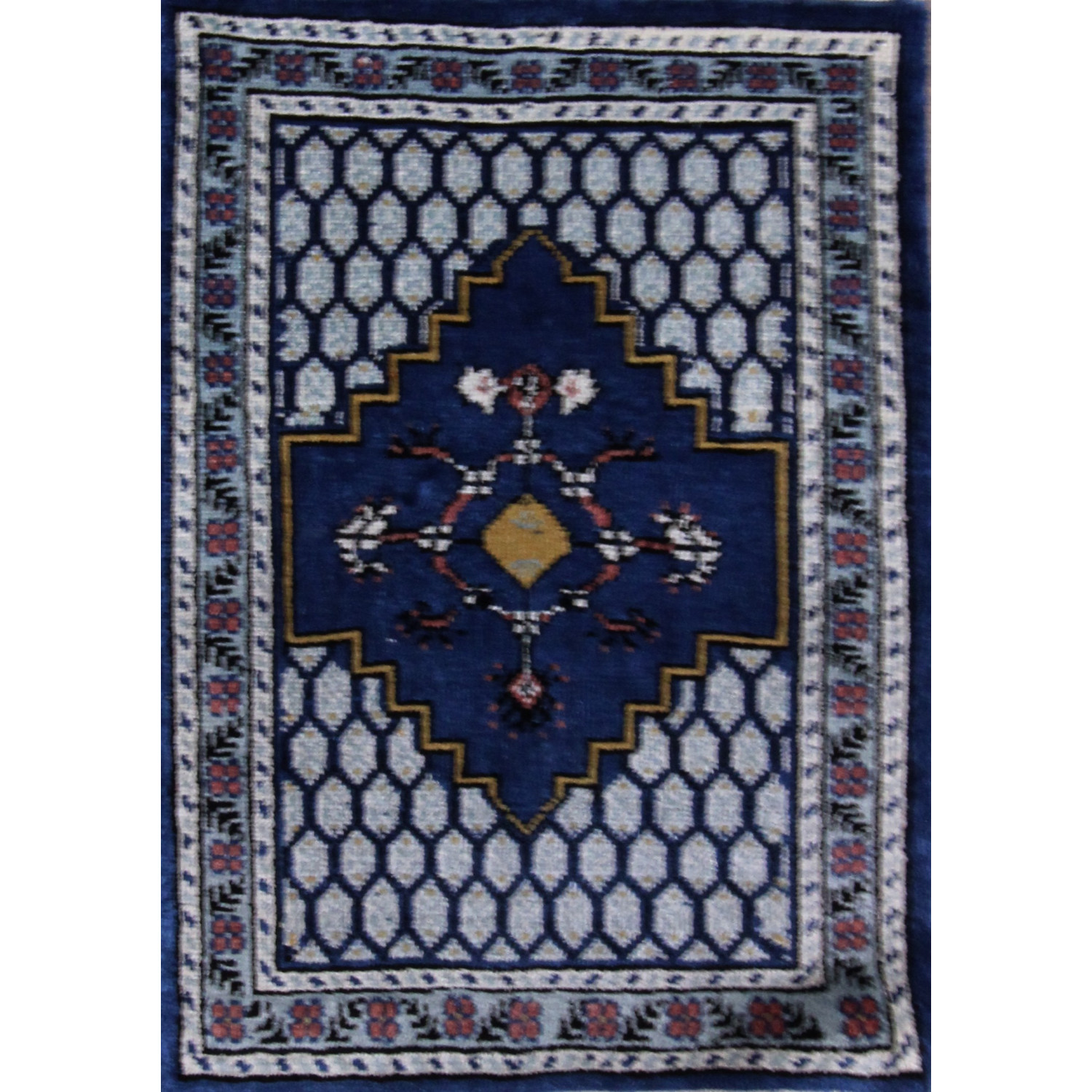 tapis artisanal motif bleu. Black Bedroom Furniture Sets. Home Design Ideas